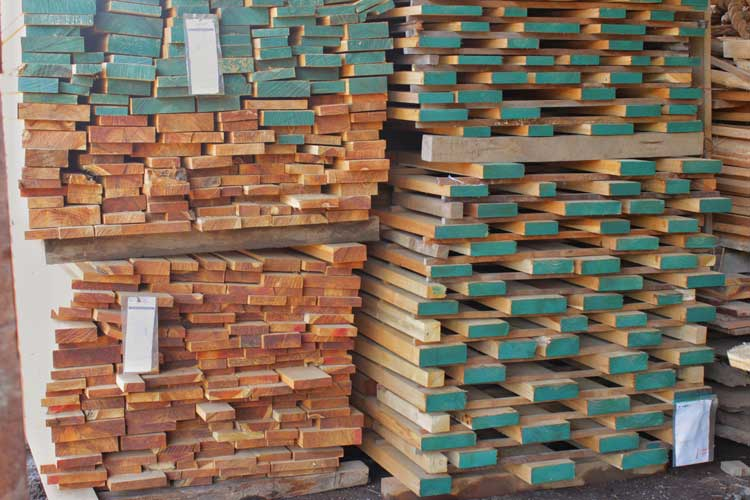 Dried teak stacked and ready for shipment