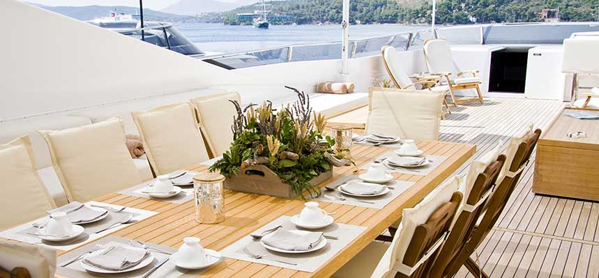 Yacht with teak wood furniture and teak decking