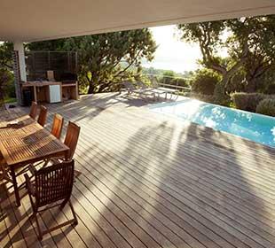 Teak flooring around pool