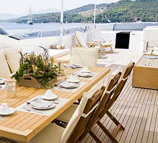 teak furniture and decking on a yacht