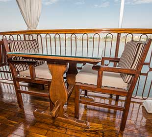 Teak table and chairs on river boat
